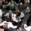 Mankato West's Derek Frentz (7) celebrates with fans after scoring his third goal of the game against Red Wing in the Section 1A boys hockey tournament Thursday at All Seasons Arena.
