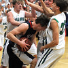 St. Peter's Josh Peymann is surrounded by (from left) Maple River's Jonah Breiter, Zach Krengel and Will Keller during the first half Thursday in St. Peter.