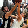 St. Peter's Peter Kruize (left) and Maple River's Jonah Breiter reach for a loose ball during the first half Thursday in St. Peter.