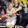 Minnesota State's Ali Wilkinson looks to pass out of the double team of University of Sioux Falls' Amber Paden (back) and Teagen Molden during the first half Friday at Bresnan Arena.