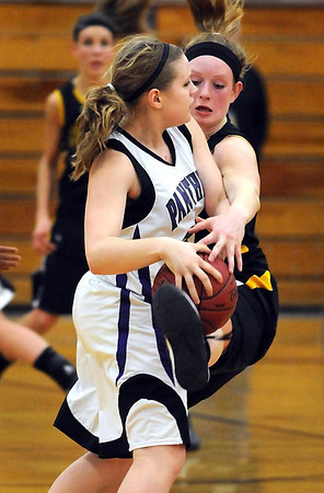 Mankato East's Claire Ziegler uses her hands and feet to knock the ball away from Glencoe-Silver Lake's Erin Nowak during the first half of their Section 2AAA tournament game Tuesday at the East gym.
