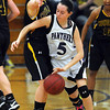 Glencoe-Silver Lake's Madison Monahan tries to get around Mankato East's Marta Anderson during the first half of their Section 2AAA tournament game Tuesday at the East gym.