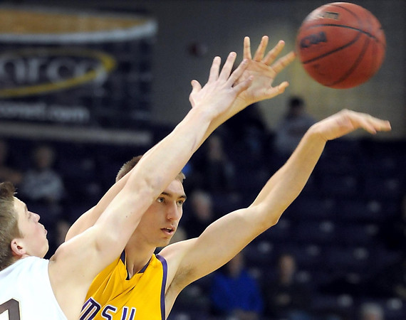 Minnesota State's Connor O'Brien passes the ball away from Southwest Minnesota State's Jordan Miller during the first half Saturday at Bresnan Arena.
