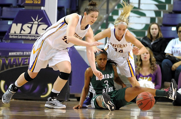Minnesota State's Ali Wilkinson (42) and Ashley Olson (14) scramble for the ball after knocking it away from Bemidji State's Lanae Rash during the second half of their NSIC tournament game Wednesday at Bresnan Arena.