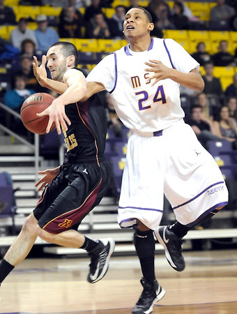 Minnesota State's Jimmy Whitehead is fouled by University of Minnesota, Crookston's Almir Krdzalic during the first half of their NSIC tournament game Wednesday at Bresnan Arena.