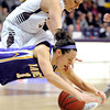 Southwest Minnesota State's Rebekah Rolling and Minnesota State's Alli Hoefer dive for a loose ball during the second half Saturday at Bresnan Arena.