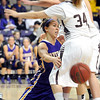 Minnesota State's Steffaney Thomas passes from her knees around a pair of Southwest Minnesota State defenders during the second half Saturday at Bresnan Arena.