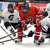 Pat Christman<br /> Mankato West's Austin Langworthy is surrounded by NEw Prague defenders as he looks to pass during the second period of their Section 1A championship game Thursday at the Rochester Recreation Center.