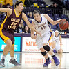 Pat Christman<br /> Minnesota State's Ali Wilkinson drives past the University of Minnesota Crookston's Megan Taylor during the second half Wednesday at Bresnan Arena.