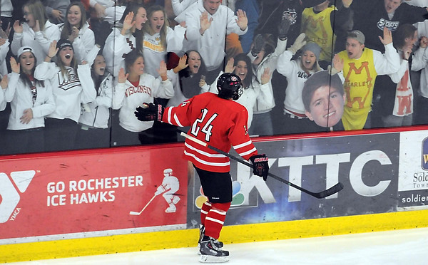 Pat Christman<br /> Mankato West's Max Mettler high fives fans through the glass after a goal in the third period fo their Section 1A championship game against New Prague Thursday at the Rochester Recreation Center.