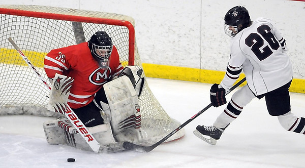 Pat Christman<br /> Mankato West goalie Conor Wollenzien makes a save on a shot by New Prague's Austin Isaacson during the first period of their Section 1A championship game Thursday at the Rochester Recreation Center.