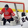 Pat Christman<br /> The puck sails over the shoulder of Mankato West goalie Conor Wollenzien for a goal during the first period of their Section 1A championship game against New Prague Thursday at the Rochester Recreation Center.