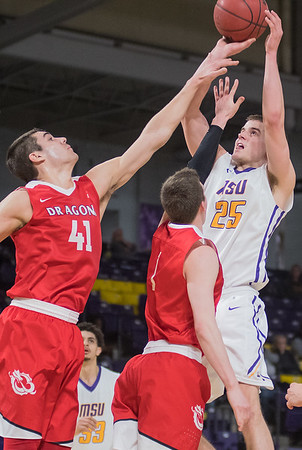 Minnesota State's Kevin Krieger (25) puts up a shot over MSU Moorhead's Addison Park (41) and Johnny Beeninga during Wednesday's game played at Bresnan Arena. The Mavericks won the first round game of the NSIC tournament 72-69. Photo by Jackson Forderer