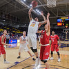 Minnesota State's Chris Kendrix (33) jumps up for a tip back over MSU Moorhead's Matt Anderson in the second half of Wednesday's game played at Bresnan Arena. The Mavericks beat the Dragons 72-69 in the first round of the NSIC tournament. Photo by Jackson Forderer