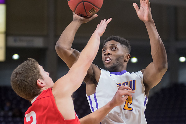 Minnesota State's Carlos Anderson puts up a jump shot over MSU Moorhead's Bryce Ersfeld in the second half of Wednesday's game played at Bresnan Arena. The Mavericks survived a late rally from the Dragons to win 72-69. Photo by Jackson Forderer