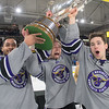 From left, Minnesota State men's hockey captains C.J. Seuss, Brad McClure and Max Coatta hoist the MacNaughton Cup after defeating Bemidji State 2-1 Friday at the Verizon Center. The MacNaughton Cup was awarded to the Mavericks for being the regular season conference champion of the WCHA. Photo by Jackson Forderer
