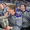 Connor Mackey (second from left) gets his hand on the MacNaughton Cup as captain Brad McClure (19) and his Minnesota State Maverick teammates begin to celebrate after defeating Bemidji State 2-1 on Friday. Photo by Jackson Forderer
