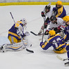 A scramble ensues in front of Rochester Lourdes goalie Ryan Smith as the Mankato West Scarlets had their goalie pulled and tried to fight back from being down 2-1 late in the third period. Photo by Jackson Forderer