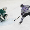 Minnesota State's Marc Michaelis (20) slides the puck past Bemidji State goalie Michael Bitzer in the second period to tie that game at one. The Mavericks would go on to win 2-1 and clinch the regular season WCHA title. Photo by Jackson Forderer