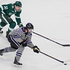 Minnesota State's Marc Michaelis (20) gets the puck on a breakaway while Bemidji State's Zach Whitecloud (32) tries to chase him down. Michaelis would score on the breakaway, scoring a breakaway goal in two consecutive games. The Mavericks tied Bemidji State with the Beavers winning the shootout. Photo by Jackson Forderer