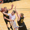Bethany Lutheran's Brady Rose (center) slips past University of Minnesota-Morris defenders Trey Heinsuis (left) and Nick Peterson (23) during the Vikings home game played on Wednesday. The Vikings won the first round of the UMAC postseason tournament in a 112-69 blowout. Photo by Jackson Forderer