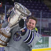 Minnesota State's Connor LaCouvee takes a lap with the MacNaughton Cup after the Mavericks defeated Bemidji State 2-1 on Friday to clinch the regular season WCHA title. Photo by Jackson Forderer