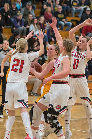 Mankato East's Mackenzie Schweim (center) is surrounding by Mankato West defenders, from left, Lani Schoper, Claire Hemstock and Briana Stoltzman while trying to put up a shot in Friday's game. Photo by Jackson Forderer