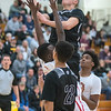Jax Madson of Mankato East goes up for a shot while Mankato West's Pal Kueth defends the basket in the second half of Saturday's game played at East. Photo by Jackson Forderer