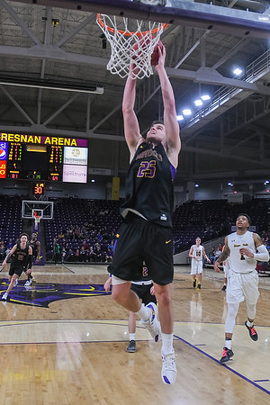 Minnesota State's Kevin Krieger goes in for an easy dunk as the Wayne State press late in the second half allowed for some easy baskets for the Mavericks during a game played on Feb. 16. Photo by Jackson Forderer