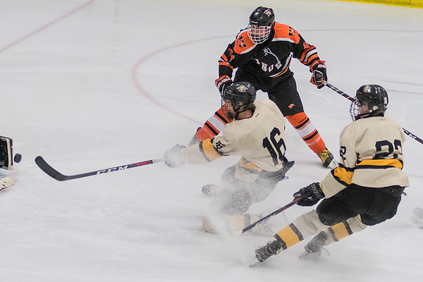 Mankato East/Loyola's Sam Schulz takes a shot on goal from one knee in the first period of Thursday's Section 1A playoff game against Winona. Photo by Jackson Forderer