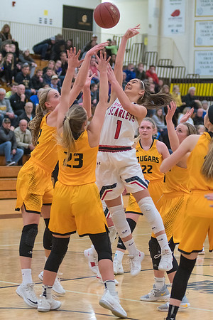 Holly Wiste (1) of Mankato West has her shot tipped by Lexi Karge (left) of Mankato East with Abby Grams (23) defending the way to the basket in the first half of Friday's game. Photo by Jackson Forderer