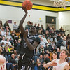 Mankato East's Lero Oman goes in for a breakaway layup in the final seconds of Saturday's game against Mankato West. Photo by Jackson Forderer