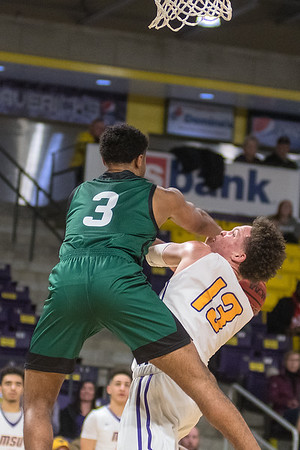 Minnesota State's Tre Baumgardner (13) struggles to get off a shot against Bemidji State's Ja Morgan in the Maverick's 66-56 loss in the first round of the NSIC conference tournament. Photo by Jackson Forderer