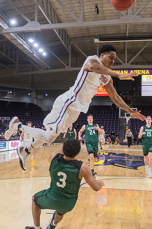 Minnesota State's Jamal Nixon knocks over Bemidji State's Ja Morgan during a fast break as the Mavericks attempted to make a come back in the second half of Wednesday's game. Nixon was called for a charge on the play in the Mavericks loss to the Beavers. Photo by Jackson Forderer