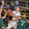 Minnesota State's Quincy Anderson goes up for a shot while being defended by Bemidji State's Jacob Hoffman (left) and Ja Morgan during Wednesday's game played at Bresnan Arena. Photo by Jackson Forderer