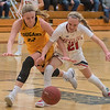Lexi Karge (left) of Mankato East and Lani Schoper (right) of Mankato West fight for a loose ball in the second half of Friday's game played at East. Photo by Jackson Forderer