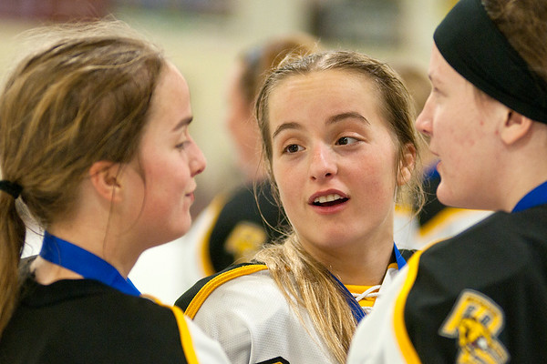 The Kanstrup twins, Taylor and Bailey, talk with each other after defeating Marshall 4-2 in the Section 3A final that sent the Mankato East/Loyola girls hockey team to the state tournament. Photo by Jackson Forderer