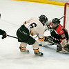 Winona/Cotter's Alex Benson (29) makes a last second pad save against Mankato East/Loyola's Nick Salzle (6) in  the second period of the Section 1A tournament. The rest of the game fared better for Salzle and the Cougars however, as they poured in 10 goals against Winona/Cotter. Photo by Jackson Forderer