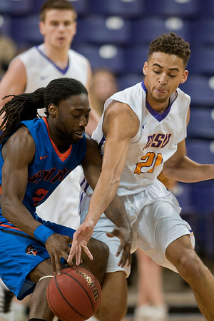 Minnesota State's Cameron Kirksey tries to steal the ball away from University of Mary's Damonta Henry. Kirksey added 12 points in MSU's 87-78 win. Photo by Jackson Forderer