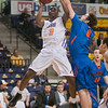 Aarias Austin (3) of Minnesota State hangs in the air before putting up a shot against University of Mary's Pat Thomas (4) in Wednesday's conference game played at Bresnan Arena. Austin led the Mavericks in scoring with 25 points in MSU's 87-78 win over the Marauders. Photo by Jackson Forderer
