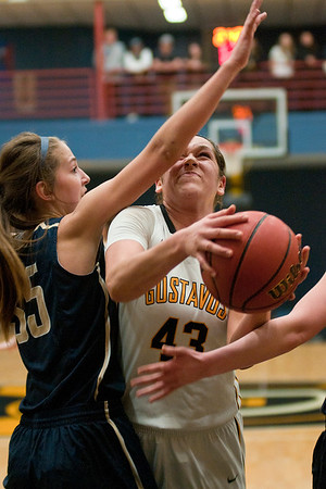Gustavus' Miranda Rice (43) tries to get a shot up in the lane against Bethel's Hannah Johnson in the first half of the MIAC semifinal game played in St. Peter. The Gusties beat Bethel to head to the MIAC final playoff game against St. Thomas. Photo by Jackson Forderer