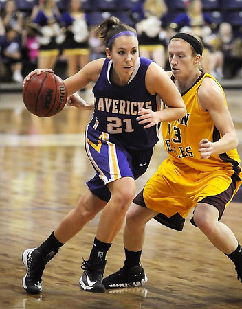 John Cross<br /> Minnesota State's Steffany Thomas drives by Minnesota, Crookston's Carli Bunning during first period action at Bresnan Arena on Saturday.