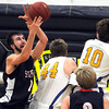 St. Peter's Peter Kruize brings in a reboud behind Waseca's Jake Busse (44) and Thomas O'Neil (10) during the second half Thursday in St. Peter.