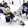 Mankato East/Loyola's Kelsey Ekstedt slides as she tips the puck in front of St. Peter/Le Sueur-Henderson/Tri City United goalie Veronica Sinell during the first period of their Section 2A playoff game Thursday at All Seasons Arena.