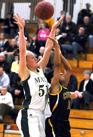 Mankato East's Minnie Frederick puts up a shot after colliding with Rochester Mayo's Rachael Doll during the first half Tuesday at the East gym. The shot found the basket for Frederick's 1,000th career point.