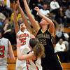 John Cross<br /> Mankato East's Allison Taylor battles Winona's Amanda Stadtler (25) and Anna Edy for a rebound.