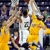 Pat Christman<br /> Minnesota State's Assem Marei, left, and Gage Wooten try to block a shot by University of Sioux Falls' Charles Ward during the first half Saturday at Bresnan Arena.
