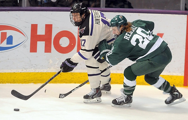 Pat Christman<br /> Minnesota State's Michael Huntebrinker is pursued by Bemidji State's Sam Rendle during the first period Saturday at the Verizon Wireless Center.