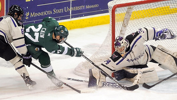 Pat Christman<br /> Bemidji State's Mitch Cain has his shot blocked by Minnesota State goalie Cole Huggins during the first period Saturday at the Verizon Wireless Center.