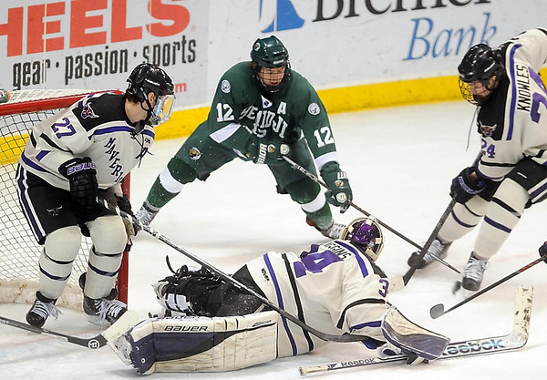 Pat Christman<br /> Bemidji State's Jeff Jubinville looks for a shot around Minnesota State's Brett Stern (27), goalie Cole Huggins and Brett Knowles (24) during the first period Saturday at the Verizon Wireless Center.